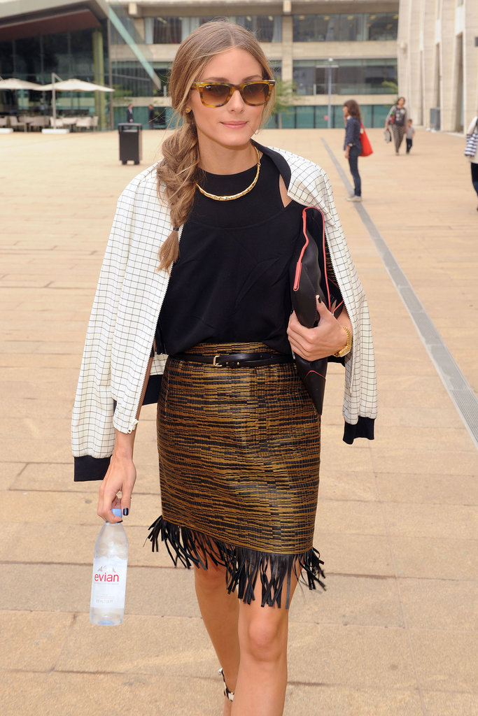 The always well-dressed Olivia Palermo stayed polished (and hydrated) at the tents.