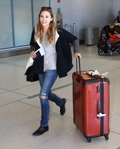 Elizabeth Olsen also arrived in Toronto looking comfy in ripped denim and an oversize jacket.