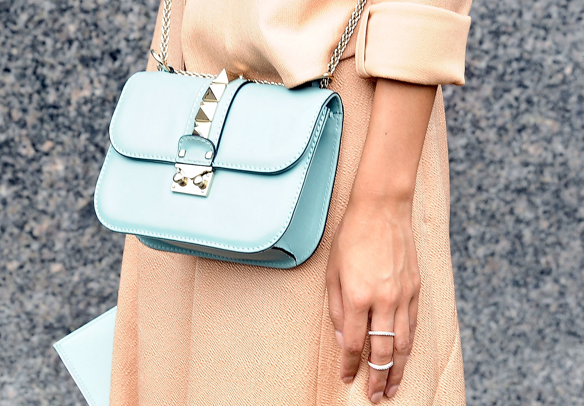 A pale blue bag was a perfect match against a pstel dress.