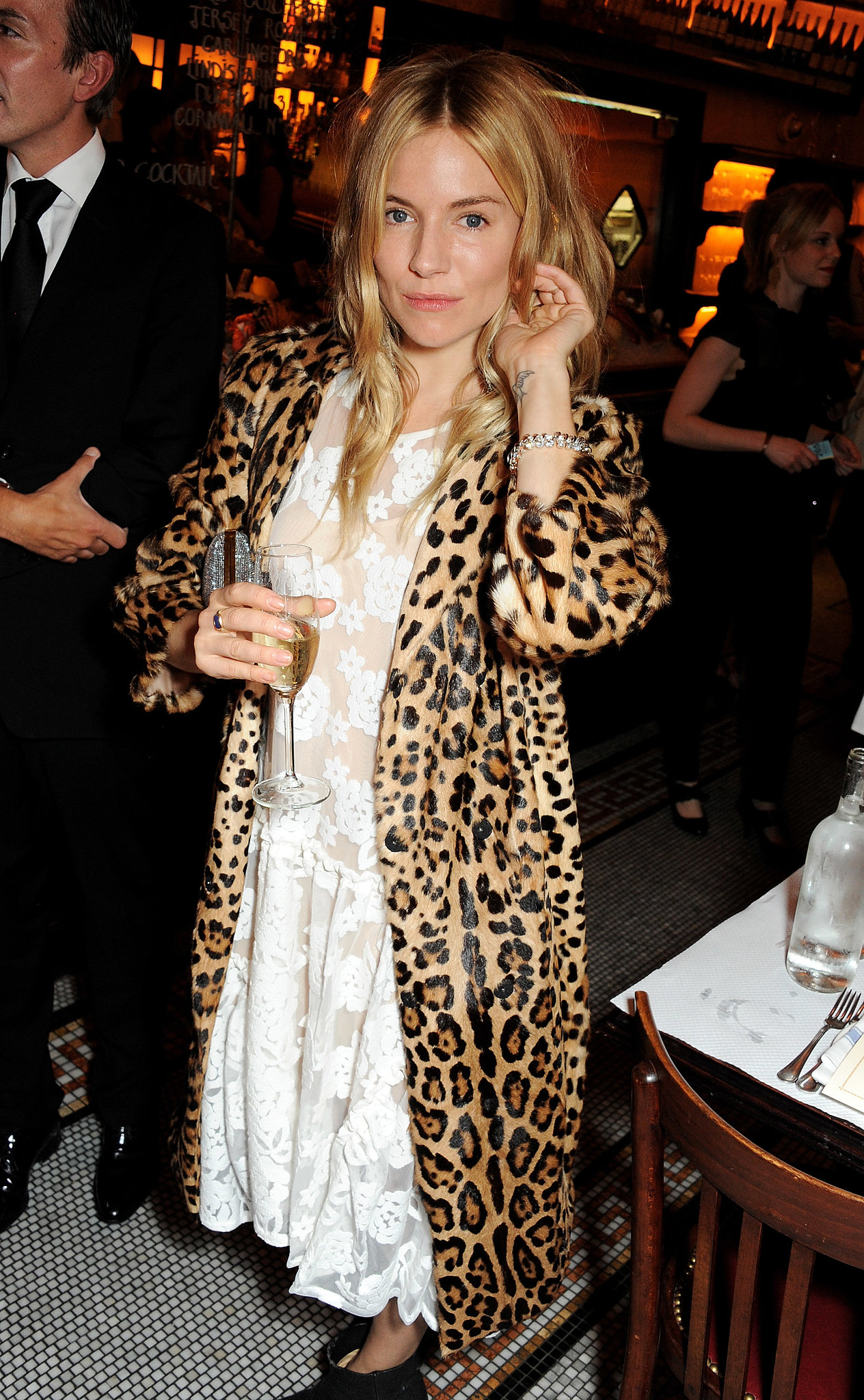 Sienna Miller wore a leopard coat to the British Vogue dinner.