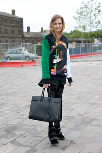 Luxe pieces abound in this cool ensemble, from her Saint Laurent bag to her Givenchy sweatshirt and Isabel Marant boots.