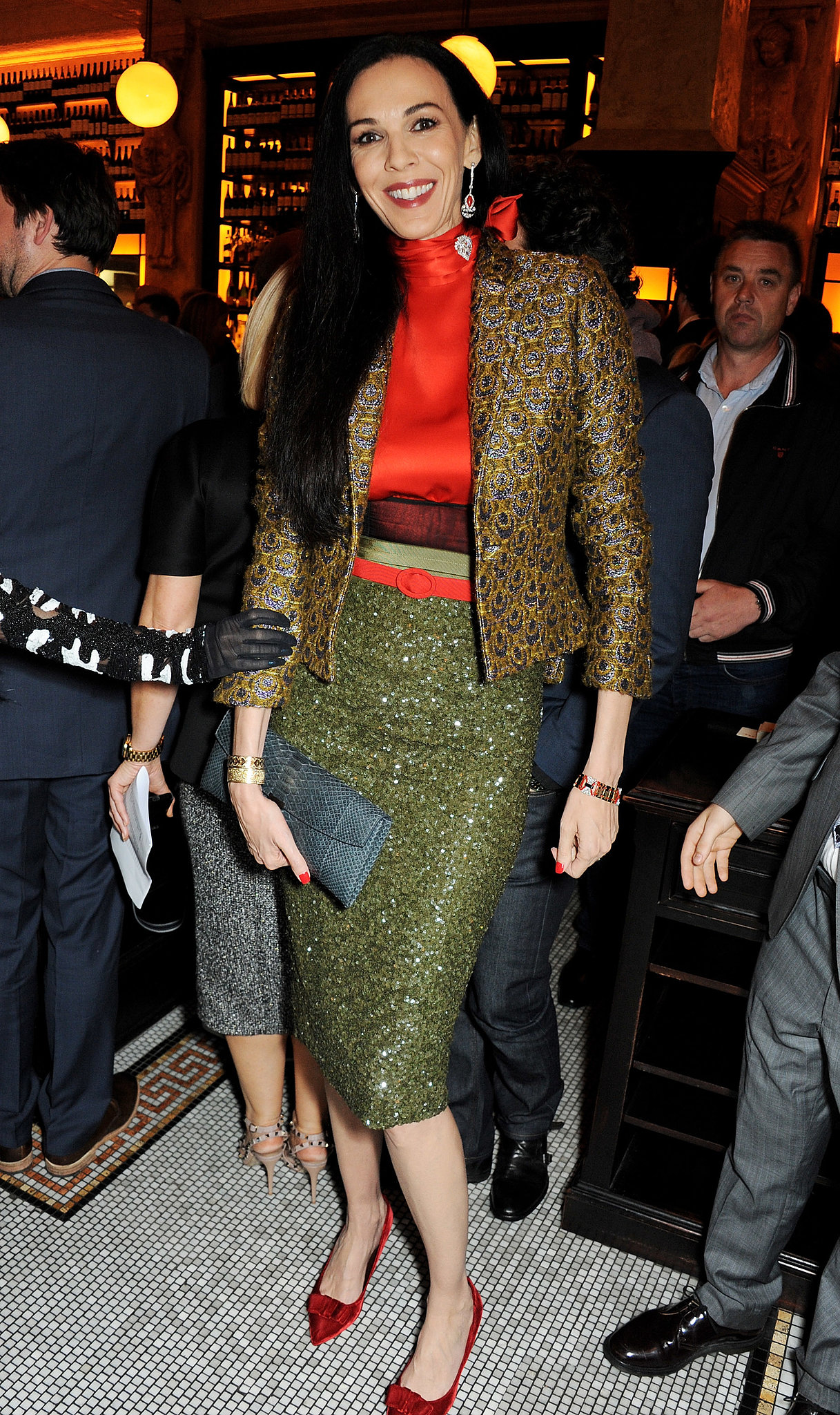 L'Wren Scott was all legs in her chic pencil skirt while dining with British Vogue.