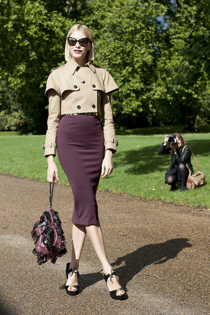 Elena Perminova matched her lipstick to her skirt and topped of the look with a sharp, cropped trench.