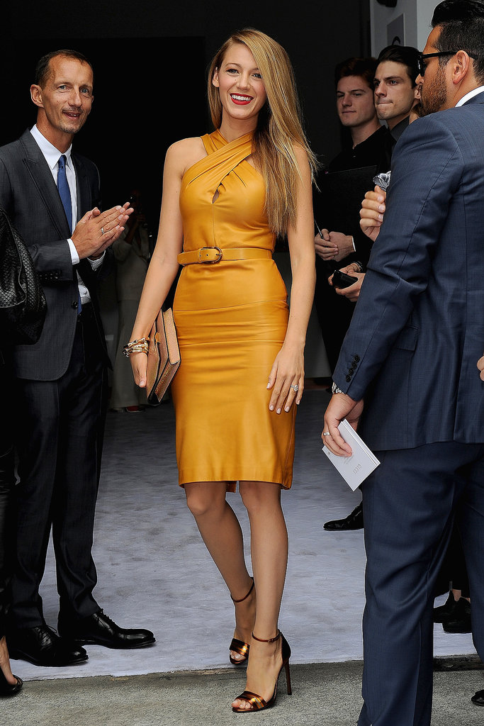 Blake Lively arrived to Gucci in a sexy leather dress in a rich caramel hue, which she accessorized with a pair of strappy sandals — and a gorgeous red lip.