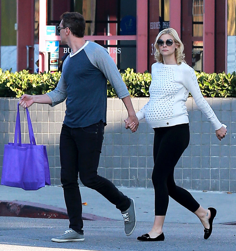 Jaime covered her baby bump in the chicest way possible — a textured white sweater — then kept her bottom half basic in black leggings.