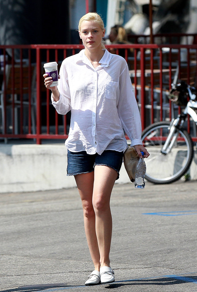 A cool white button-down with denim cutoffs and white loafers is the way the pregnant Jaime King grabs her morning coffee.
