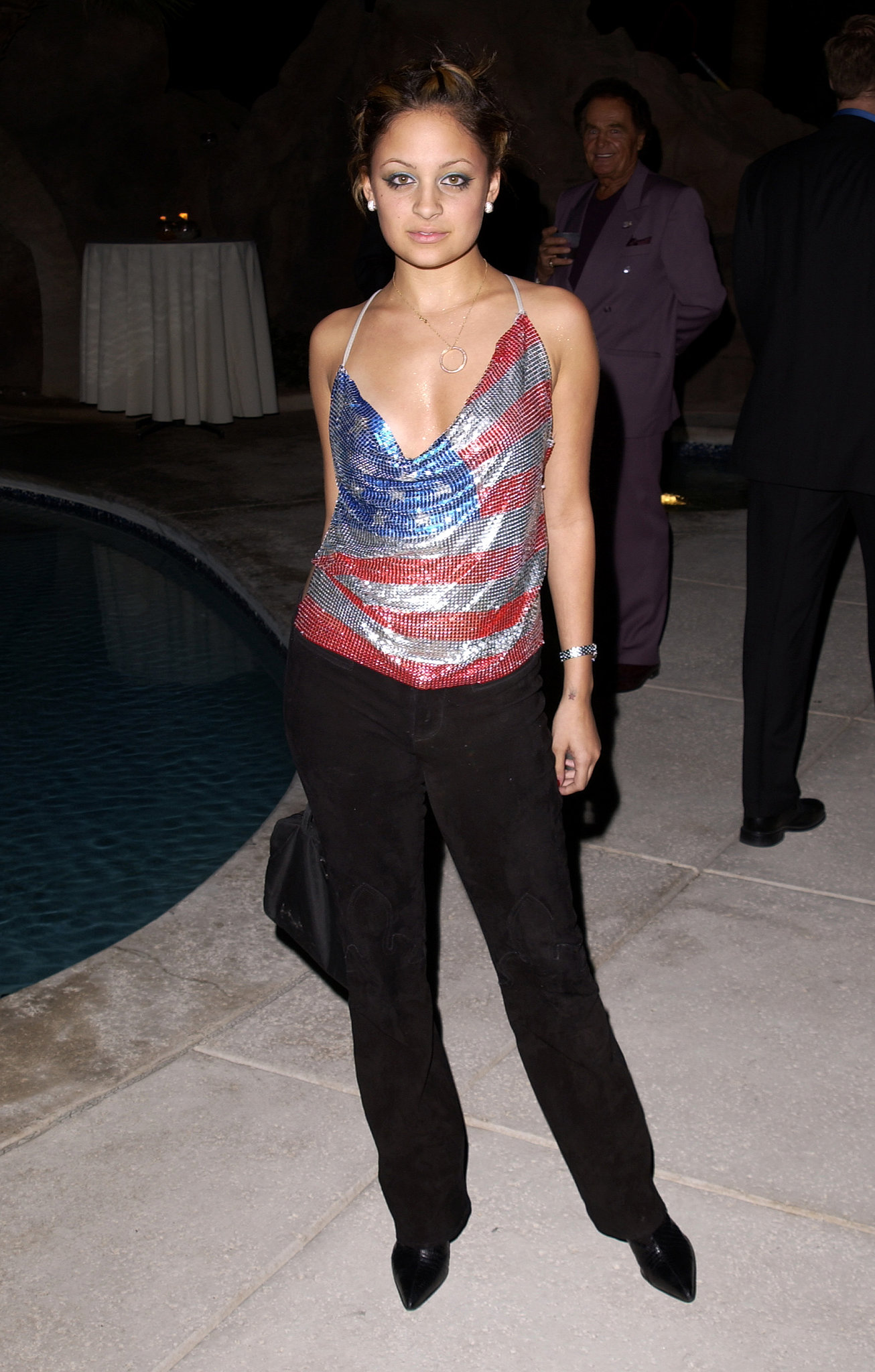 Nicole showed off her patriotic side in a slinky American flag print top at a Las Vegas club opening in November 2001.