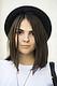 A silky, straight lob looks beautiful tucked under a cap. Source: Le 21ème | Adam Katz Sinding