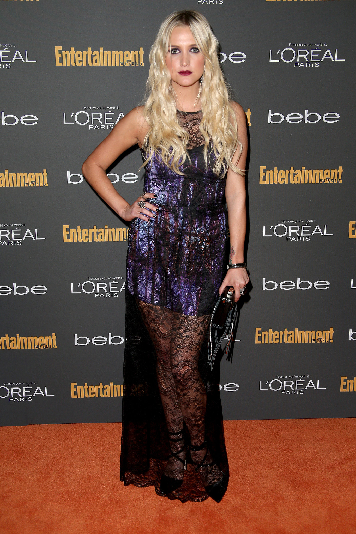 Ashlee Simpson kept it goth in a printed dress with a black lace overlay, and Alice + Olivia heels, at the Entertainm