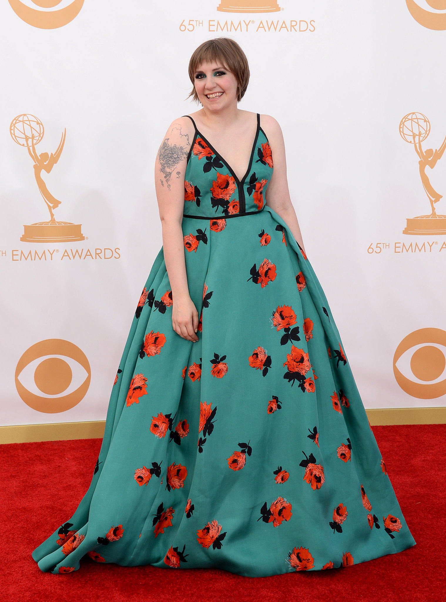 Girls star Lena Dunham was all smiles on the Emmys red carpet.