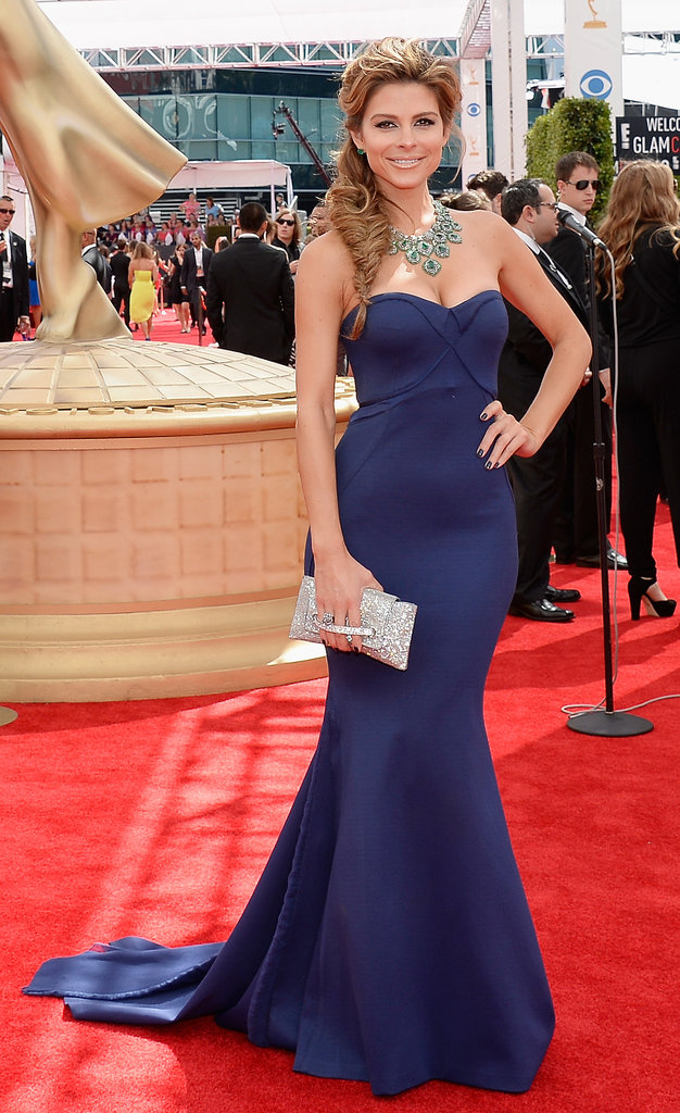 A navy dress was simple but stunning on Maria Menounos, who got her sparkle courtesy of a statement necklace and Daniel Swarovski clutch.