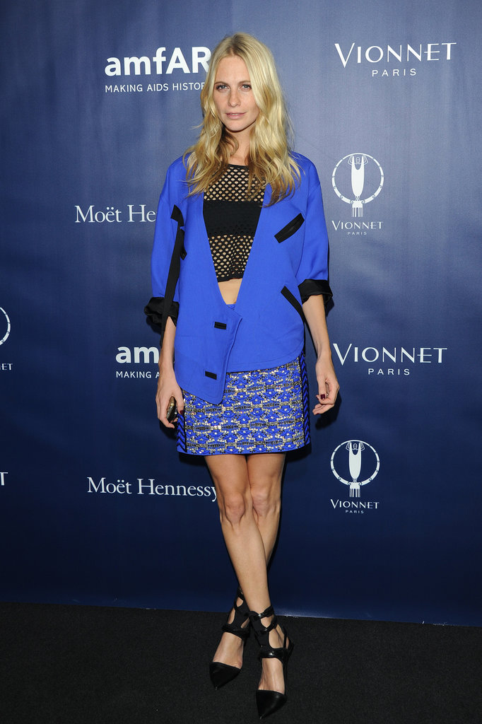 At the at the amfAR Milano afterparty, Poppy Delevingne's electric blue pieces popped majorly while a netted crop top and ankle-strap pumps gave her a hint of edge.