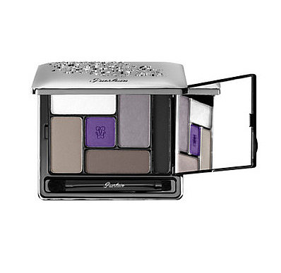Create a smoky eye with a flash of purple by combining all the shades in Guerlain's Ecrin 6 Couleurs Precious eye shadow palette ($86).
