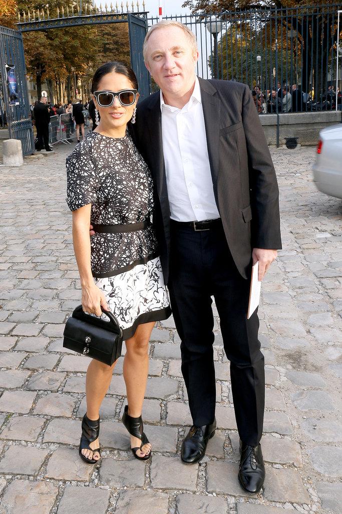 Salma Hayek and Francois-Henri Pinault dropped by the Balenciaga show on Thursday.