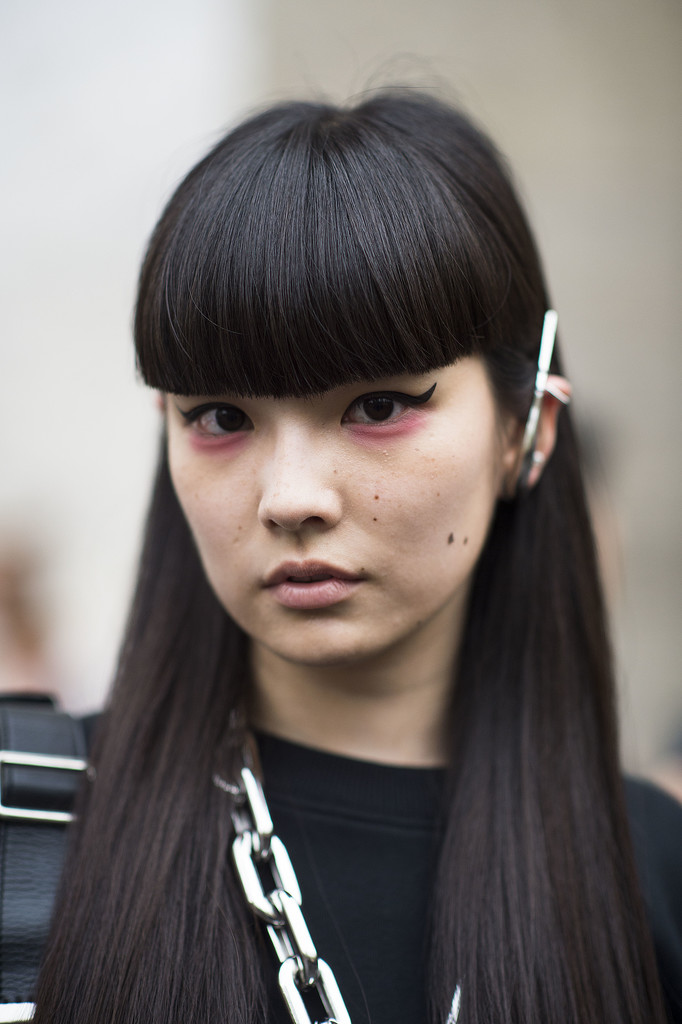 This blunt bangs/pink shadow/cat-eye liner combination is one of the coolest we've seen all month.  Source: Le 21ème   Adam Katz Sinding