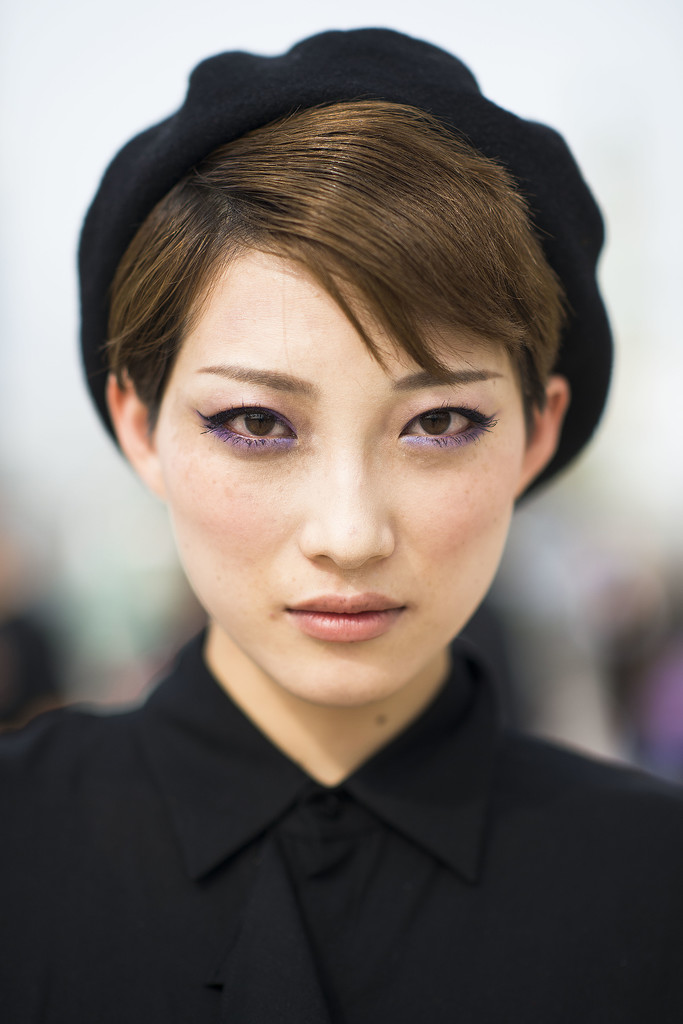 Winged eyeliner, purple shadow, and a black beret? We can't find one thing wrong with this look.   Source: Le 21ème   Adam Katz Sinding