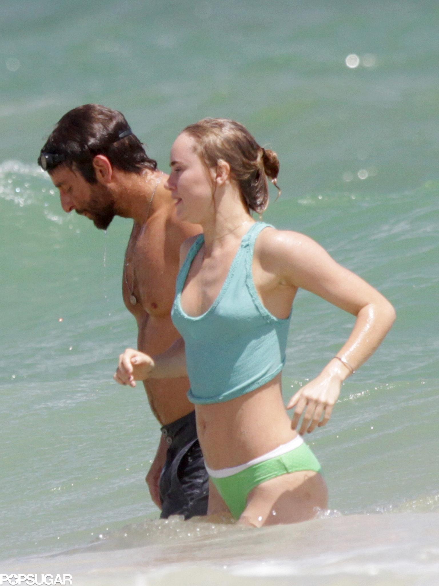 Bradley Cooper and Suki Waterhouse hit the beach during their Hawaii vacation.