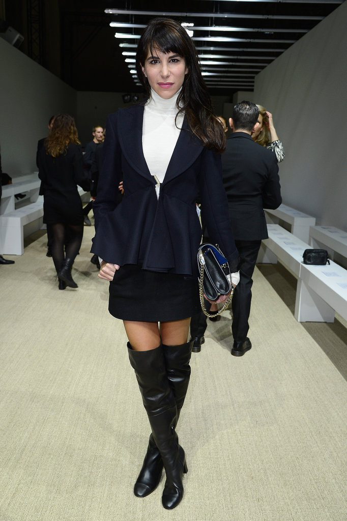 Caroline Sieber went dark in thigh-high leather boots at the Giambattista Valli show.