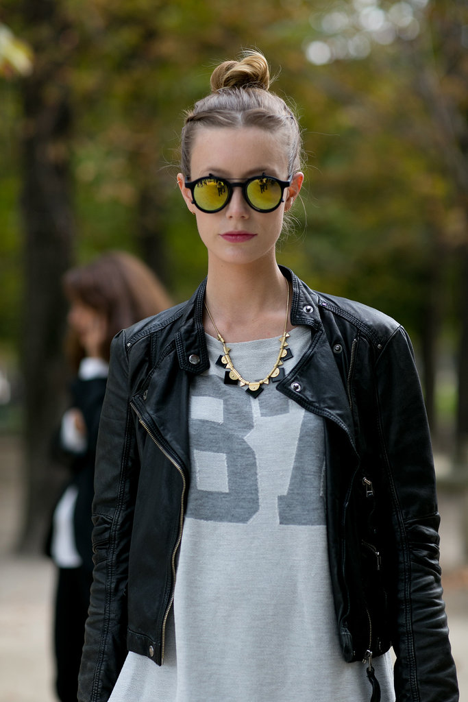 Surfer-style lenses and a quirky necklace to polish off this varsity tee.