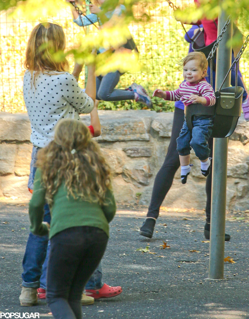 Drew Barrymore snapped photos of her daughter, Olive, as she played on the swings.