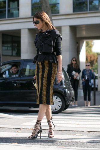 Carine Roitfeld worked her signature slim skirt, sexy shoes, and sleek shades.