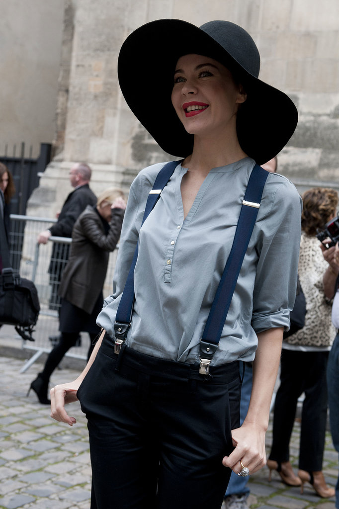 Ulyana Sergeenko shows of a floppy hat, suspenders, and a smile.