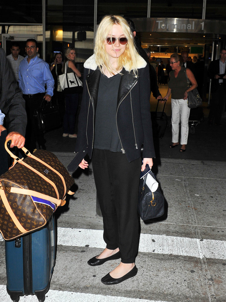 Take style cues from Dakota Fanning and layer comfy black separates for a chic, casual in-flight outfit.