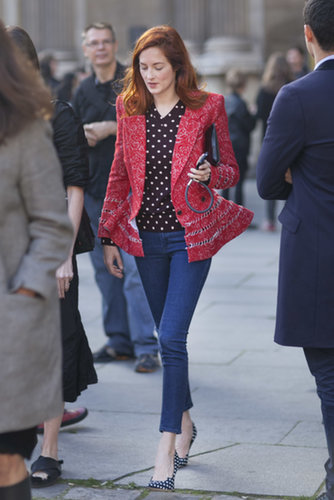 Taylor Tomasi Hill isn't afraid of mixing prints — like wearing a bold red blazer with a spotted blouse and heels.