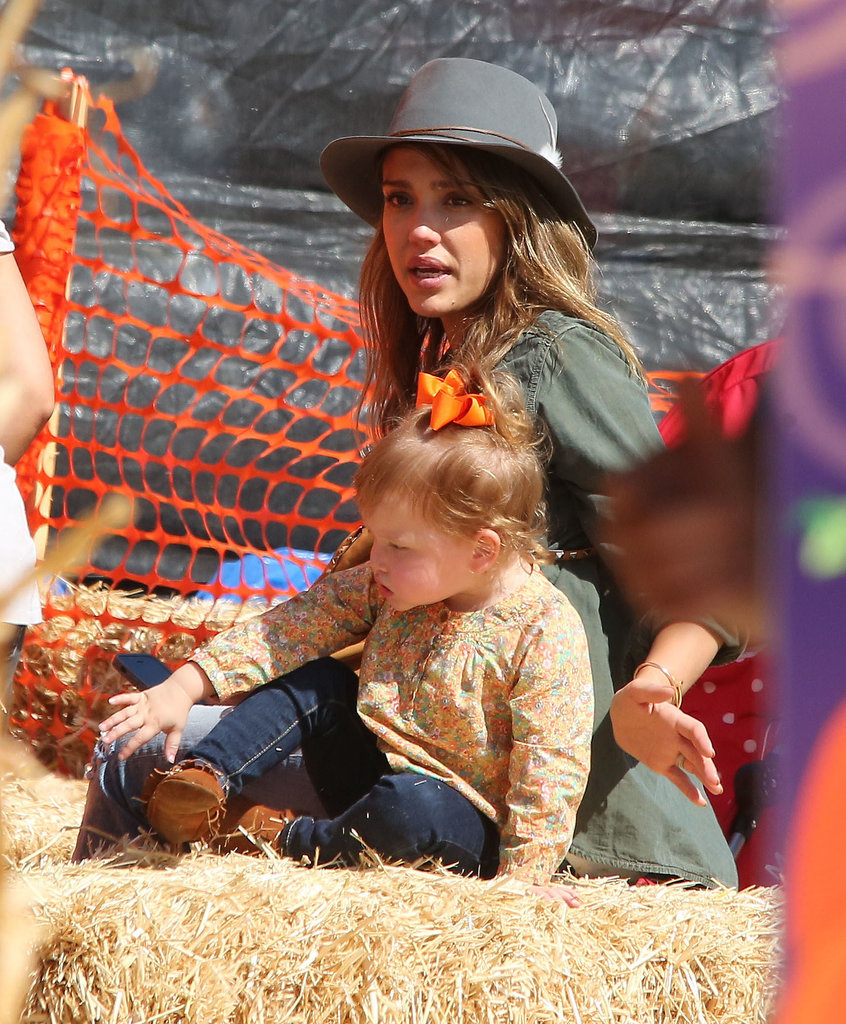 In LA, Jessica Alba sat on a bale of hay with her daughter Haven.