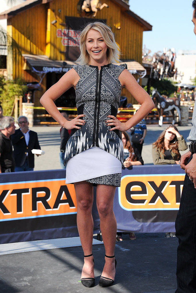 Julianne Hough debuted a sporty, mixed print minidress by Bibhu Mohapatra on the set of Extra. She complemented the busy prints of her dress with a solid pair of black anklestrap shoes.