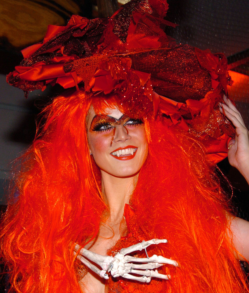 Heidi went as a redheaded witch in 2004, and to add to the Halloween theme, she had a skeleton on her back.