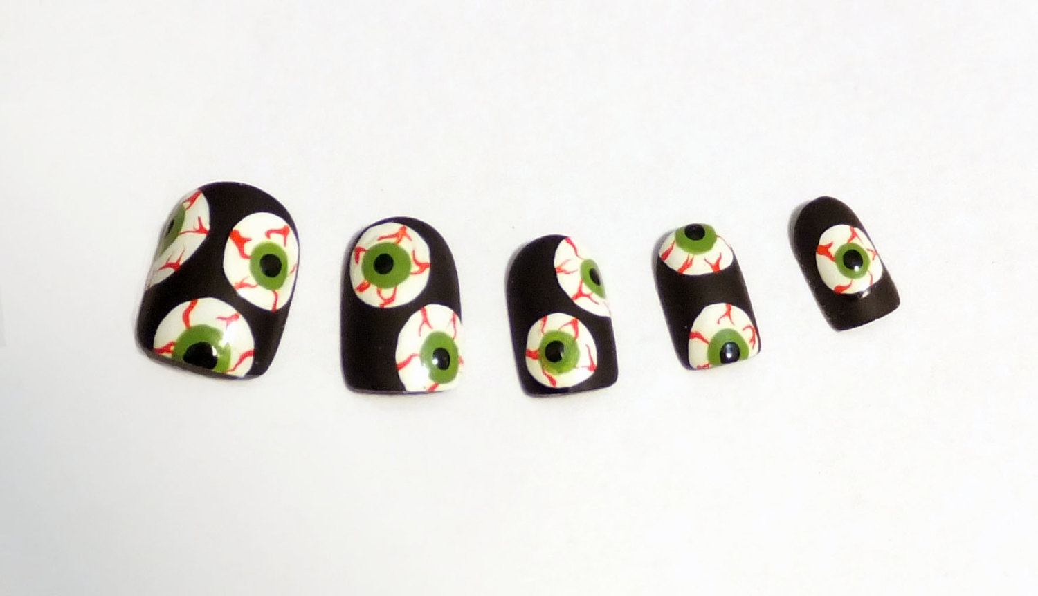Bloodshot nail art takes some serious skill, but you can still get the look with these glue-on nails ($20).