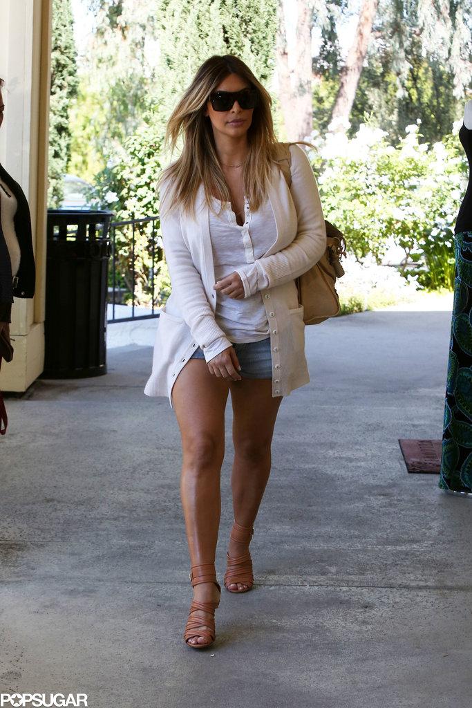 Kim Kardashian wore shorts and a sweater.