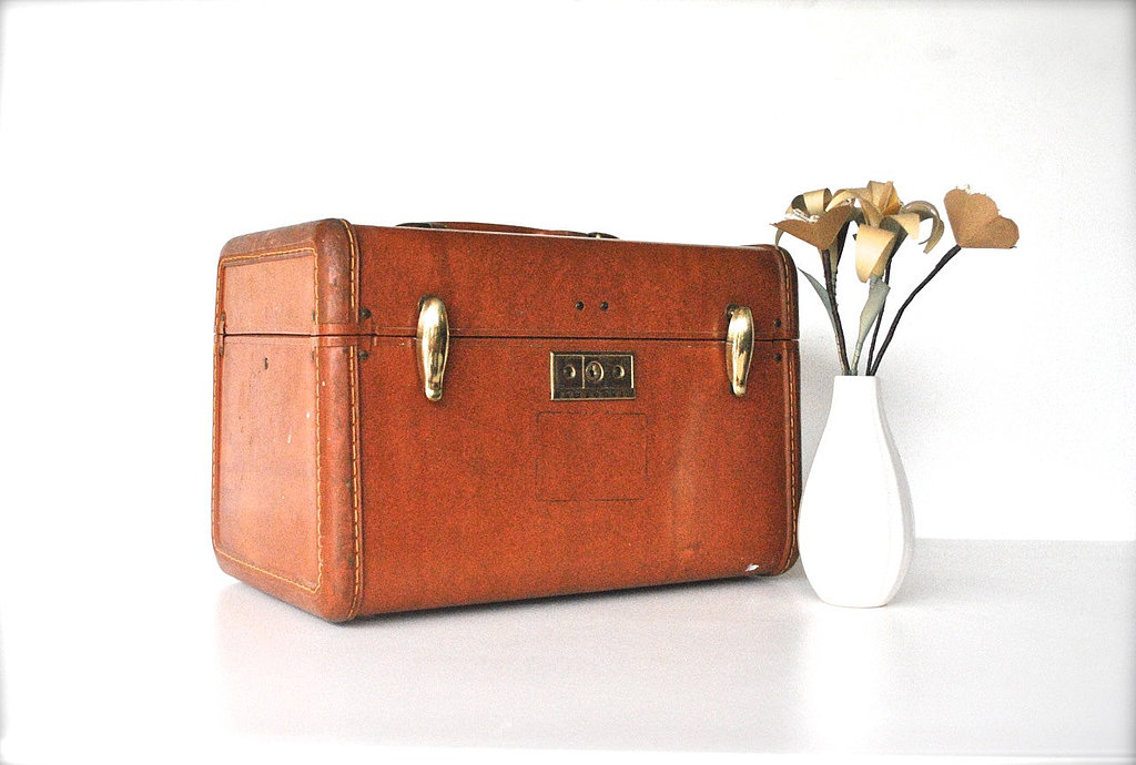 Pack all your wedding day essentials in this adorably vintage train case ($43).