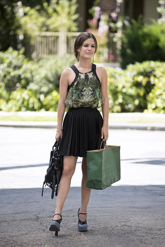 Zoe tested out the school girl trend in a printed emerald tank, pleated mini, and these colorblock Prada maryjanes ($666, originally $935). Tuck this Charlotte Russe tank ($10, originally $20) into this Alice + Olivia box mini ($297) to mimic her playful look.