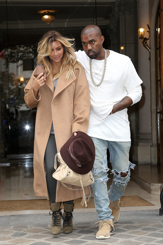 In September 2013, Kanye put his arm around Kim during an outing in Paris.