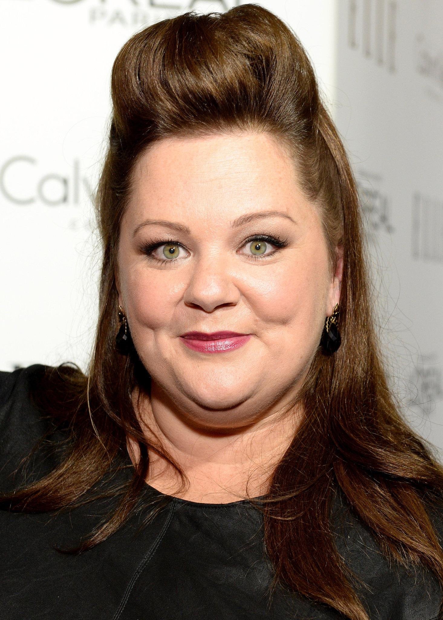 Melissa McCarthy went above and beyond with her half-up pompadour hairstyle. Her cinnamon lipstick was merely icing on the cake.