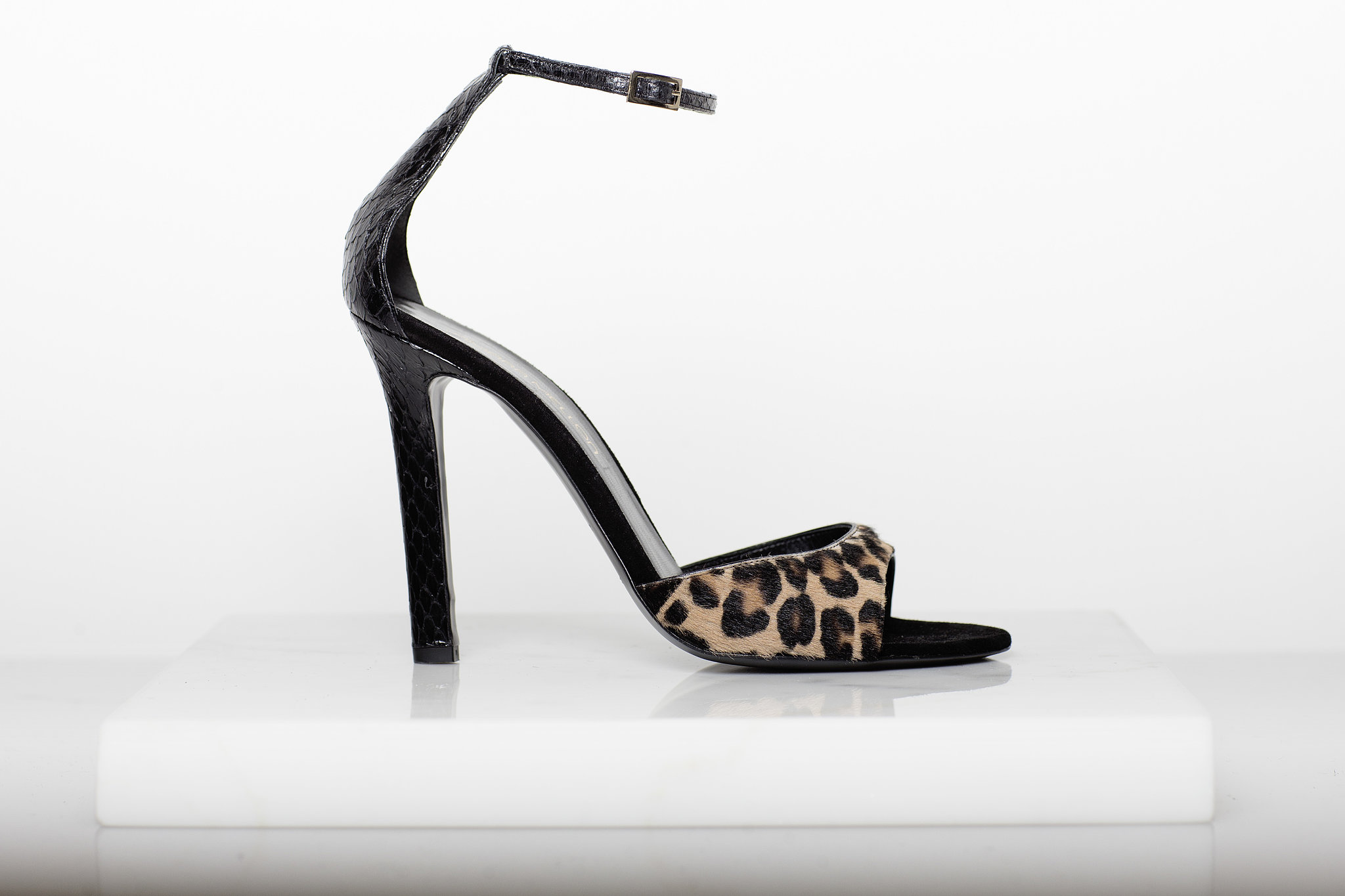 Wild Night Pony Sandal in Leopard With Black Snake Trim ($750) Photo courtesy of Tamara Mellon