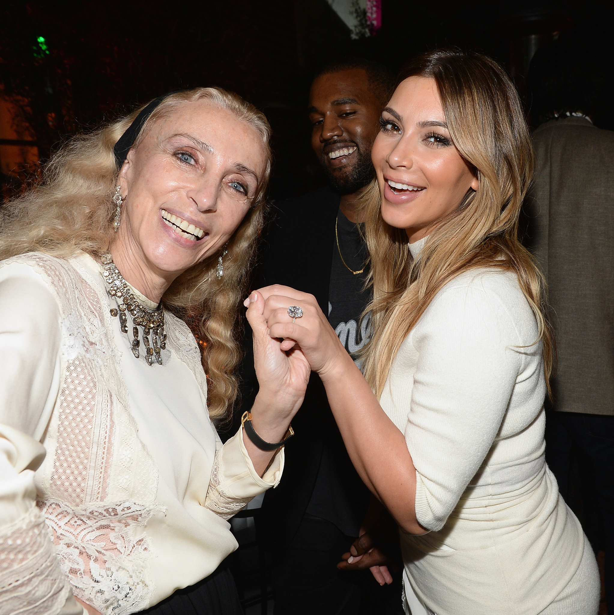 Kim Kardashian showed her ring to Franca Sozzani while Kanye West looked on.