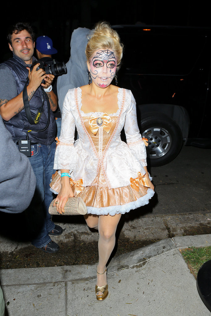Kate Upton wore face paint and a fancy dress to an LA Halloween party.