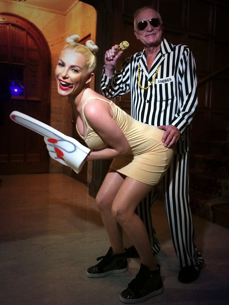Hugh Hefner sported a striped suit as Robin Thicke, re-creating the MTV VMAs performance with Crystal Harris as Miley C