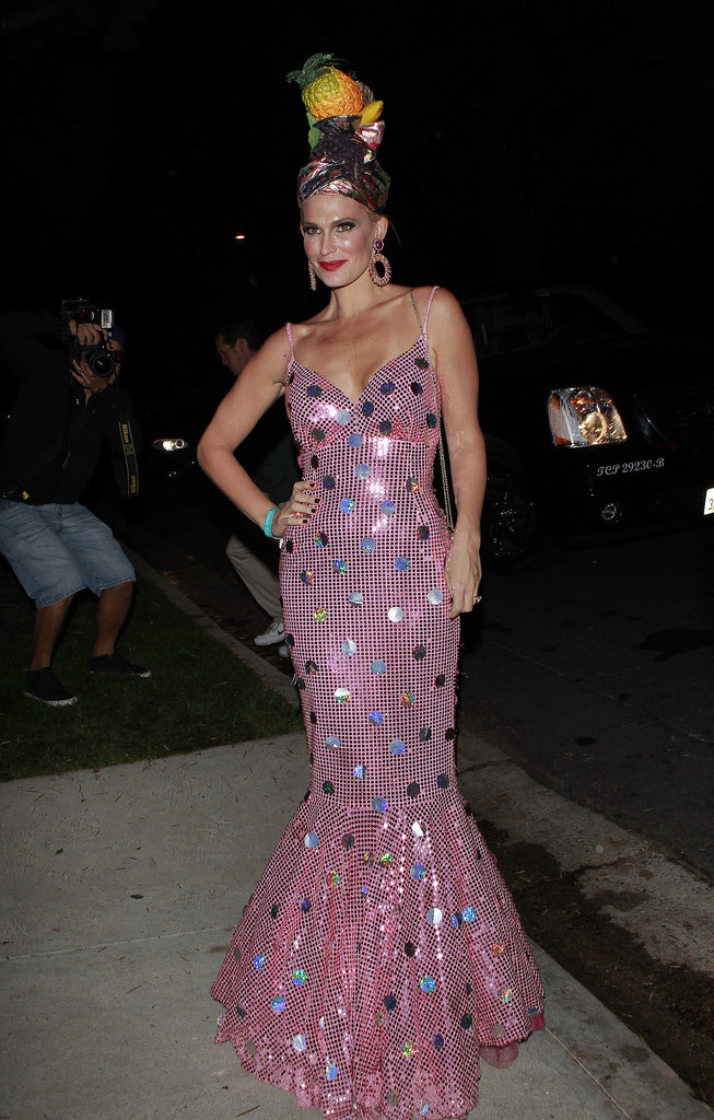 Molly Sims worked a Miss Chiquita Banana-inspired costume in a sequined fishtail gown and a tropical headpiece in 2013.