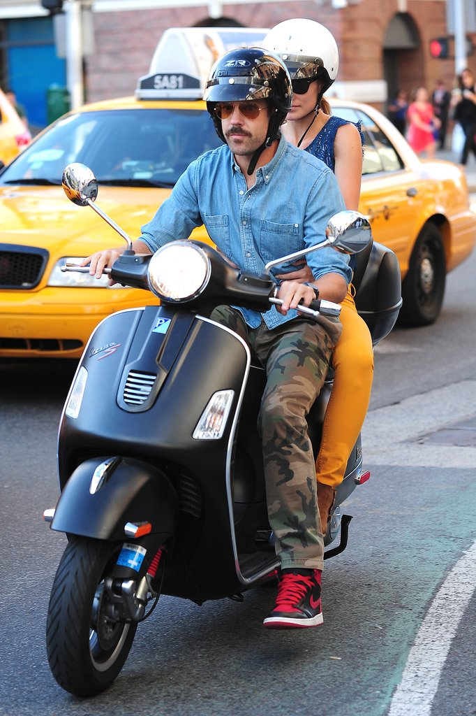 Olivia Wilde hopped on the back of Jason Sudeikis's scooter for a ride through NYC in July 2013.