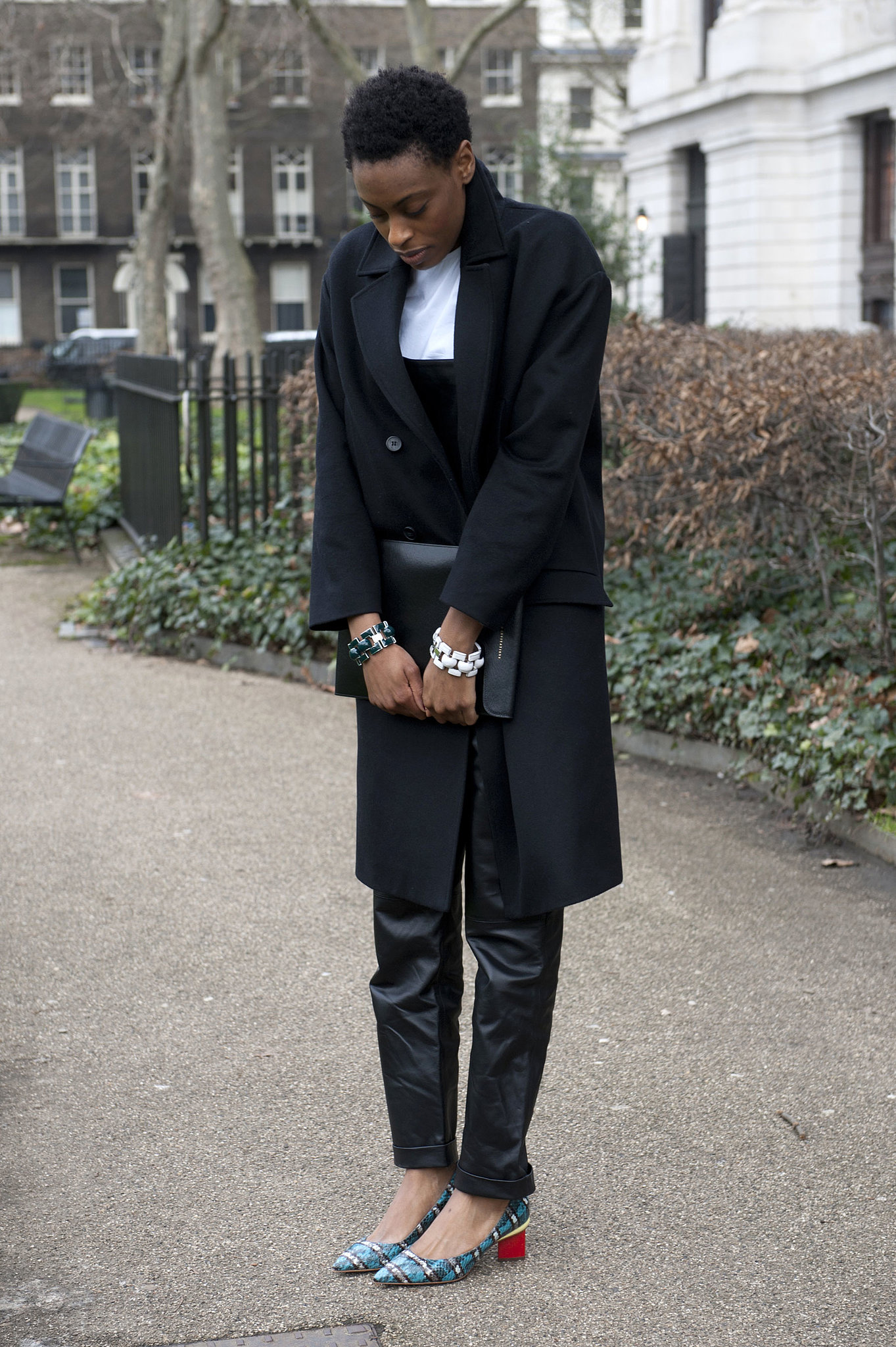 Leather pants are totally office-appropriate with chic low heels and a smart overcoat.