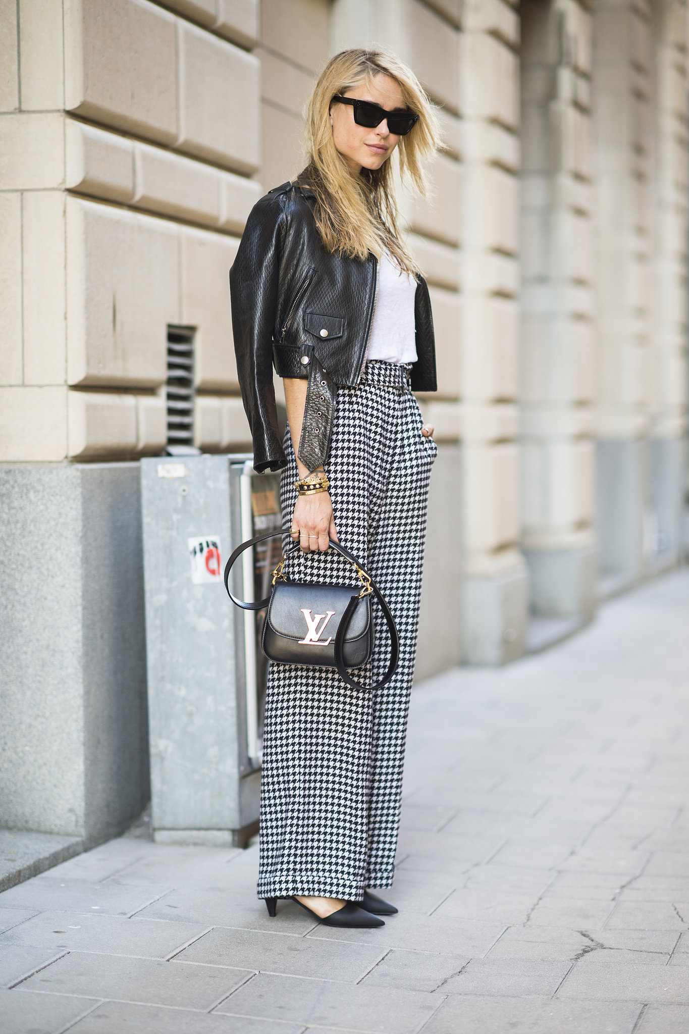 Have a little more fun with your work pants by incorporating an edgier leather jacket instead of a blazer. Source: Le 21ème   Adam Katz Sinding