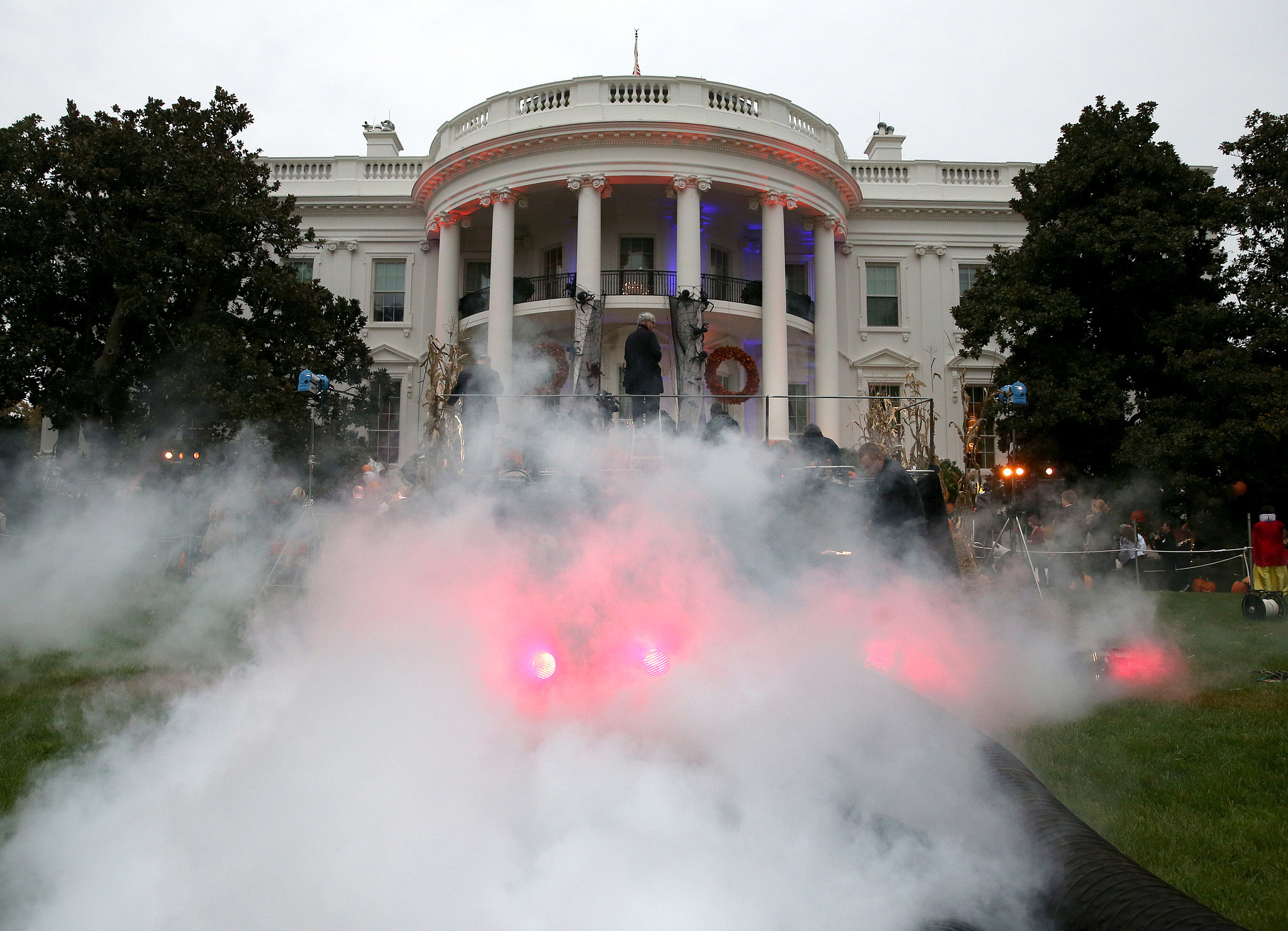 Fake smoke filled the lawn, making the White House look haunted.