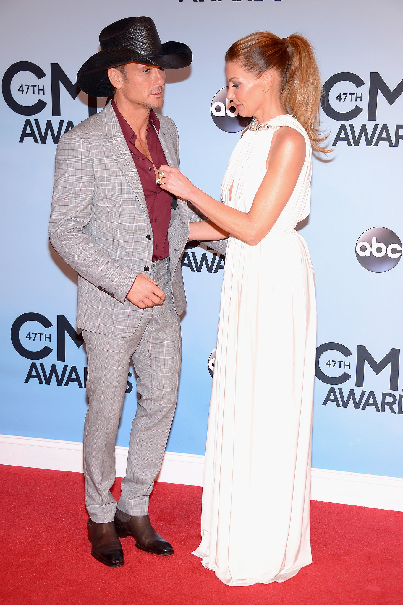 Faith Hill adjusted her husband Tim McGraw's shirt.