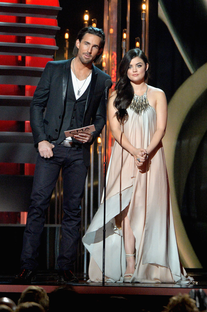Lucy Hale and Jake Owen presented together on stage.