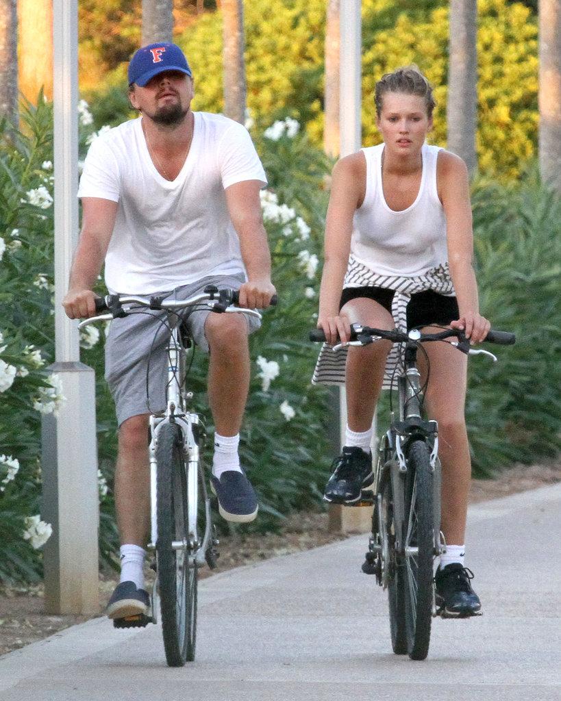 Leo rode a bike through Spain with his latest girlfriend, Toni Garnn, in August 2013.