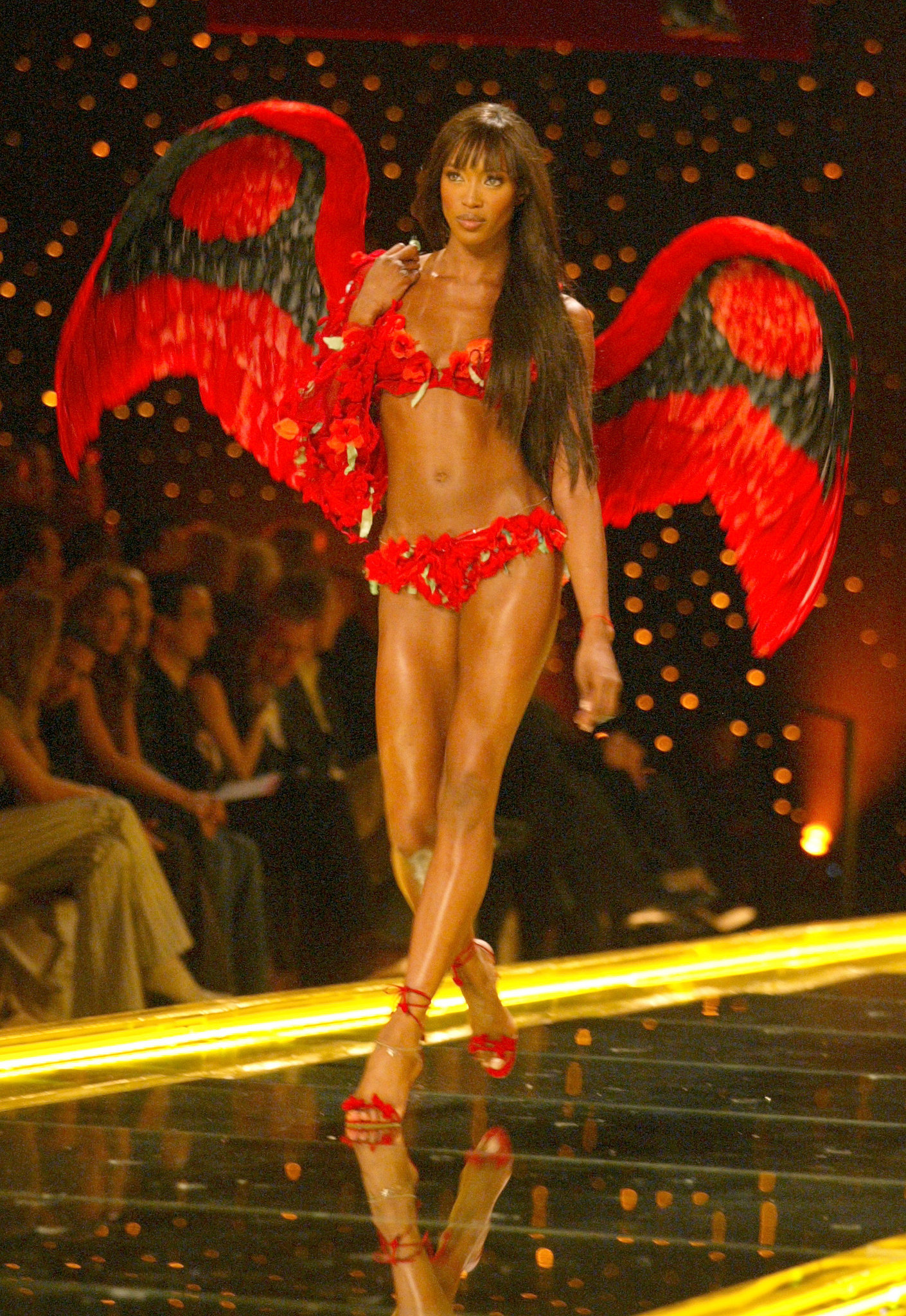 In 2003, Naomi Campbell sported polka-dot lingerie and black and red wings.